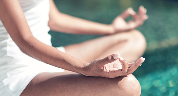 Close up Hand Gesture of Woman Doing an Outdoor Lotus Yoga Position, an Activity to Stay Physically, Mentally and Spiritually Healthy.